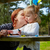 mother kissing daughter drawing colors park stock photo © lunamarina
