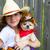 beautiful cowboy kid girl holding chihuahua with sheriff hat stock photo © lunamarina