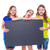 happy kid girls holding black board copyspace stock photo © lunamarina