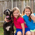 twin sisters puppy pet dog and great dane playing stock photo © lunamarina
