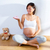 beautiful pregnant woman with baby shoes on hand stock photo © lunamarina
