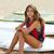 mosolyog · fiatal · nő · szörfdeszka · tengerpart · nyári · vakáció · utazás - stock fotó © lunamarina