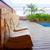 teak wood house outdoor with swing chairs and pool stock photo © lunamarina
