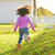 kid girl toddler playing running in park rear view stock photo © lunamarina
