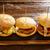 burgers in a row on a slate board stock photo © lunamarina