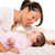 baby girl and mother lying happy playing together stock photo © lunamarina