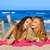 friends girls having fun laughing lying beach sand stock photo © lunamarina