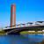 torre de sevilla and puente cachorro seville stock photo © lunamarina