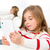 sister friends kid girls playing with tablet pc in sofa stock photo © lunamarina