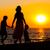 mãe · crianças · silhuetas · praia · pôr · do · sol · mulher - foto stock © macsim