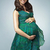 Cute brunette woman presenting the pregnancy belly stock photo © majdansky