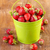 strawberry in a green metal bucket on wooden stock photo © manaemedia