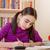 iskolás · lány · házi · feladat · toll · ír · lefelé · notebook - stock fotó © manaemedia