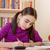 schoolgirl doing her homework stock photo © manaemedia
