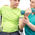 Physical therapist works with patient in lifting hands weights. foto stock © manaemedia