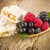 muesli bars with fresh berries in spoon on wooden stock photo © manaemedia
