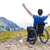 optimistic handicapped man sitting on wheelchair stock photo © manaemedia