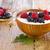 yogurt with wild berries in wooden bowl stock photo © manaemedia