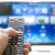 Smart tv and hand pressing remote control stock photo © manaemedia