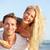 Beach couple fun - lovers on romantic travel stock photo © Maridav