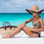 beach essentials bikini woman putting sunscreen stock photo © maridav