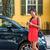 asian woman using mobile phone app for car sharing stock photo © maridav