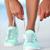 sportswoman runner getting ready tying running shoes on beach stock photo © maridav