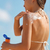 sunscreen bikini woman putting lotion on shoulder stock photo © maridav
