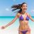 strand · leuk · vakantie · zorgeloos · vrouw - stockfoto © maridav