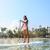 hawaii beach lifestyle woman paddleboarding stock photo © maridav