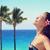 happy woman enjoying sunlight at beach stock photo © maridav