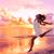 happy beautiful woman running at beach sunset stock photo © maridav