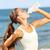 femme · de · remise · en · forme · eau · potable · entraînement · à · l'extérieur · courir · formation - photo stock © maridav