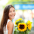 woman holding sunflower flower smiling happy stock photo © maridav