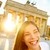 happy laughing woman at brandenburg gate berlin stock photo © maridav