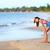 exhausted runner relaxing on beach after running stock photo © maridav