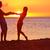 romantic couple fun on beach sunset during travel stock photo © maridav