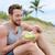healthy fit man eating organic vegan food on beach stock photo © maridav