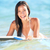 surfboard woman smiling playing in the ocean stock photo © maridav