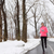 woman running in snowy city park   winter fitness stock photo © maridav