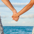 romantic couple holding hands on beach sunset stock photo © maridav