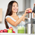 juicing   woman making apple and vegetable juice stock photo © maridav
