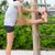 fitt · fitnessz · nő · nyújtás · kint · tengerpart · lány - stock fotó © Maridav