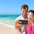 smartphone   beach vacation couple taking selfie stock photo © maridav