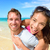young couple having fun laughing on beach holidays stock photo © maridav