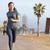 を実行して · 女性 · ジョギング · バルセロナ · ビーチ - ストックフォト © Maridav