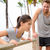 fitness instructor coaching woman doing push ups stock photo © maridav