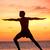 yoga man training and meditating in warrior pose stock photo © maridav