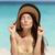 cute beach woman blowing a kiss with sun hat stock photo © maridav