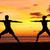 ioga · mulher · meditando · guerreiro · pose · praia - foto stock © maridav